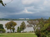 A Tropical System Low Is Just South of Here. Looking across the Lake from Winfrey Point toward Mockingbird Lane, dark clouds are about to let loose with another stock photography