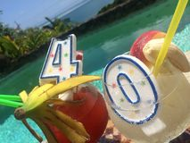 40th Happy Birthday Drinks in Paradise. There is one other version of this in my collection from a wider angle and newbirthday candles royalty free stock image