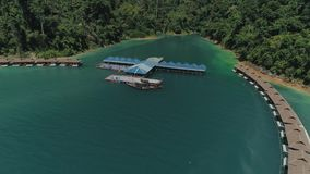 Tropical Thai jungle lake Cheo lan drone flight, wild mountains nature national park ship yacht, fishing boats. Tropical exotic green wild mountains sinset stock video footage