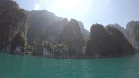 Tropical Thai jungle lake Cheo lan, island, wild mountains nature national park ship yacht rocks. Tropical exotic green wild mountains sinset jungles on stock video footage