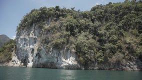 Tropical Thai jungle lake Cheo lan, island, wild mountains nature national park ship yacht rocks. Tropical exotic green wild mountains sinset jungles on stock footage
