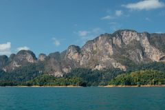 Tropical Thai jungle lake Cheo lan, wild mountains nature national park ship yacht rocks. Tropical exotic green wild mountains sinset jungles on vacations cheo Stock Photos
