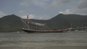 Tropical Thai jungle lake Cheo lan wood boat, wild mountains nature national park ship yacht rocks. Tropical exotic green wild mountains sinset jungles wooden stock footage
