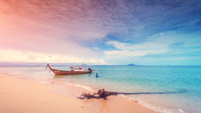 Tropical Thailand island. 4k, 24fps. Beautiful 4k timelapse of sand beach and blue sea waves. Tropical Thailand island. Long boat floating near the shore. Beauty stock footage