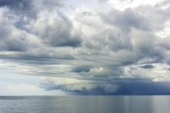 Tropical thunderstorm over the Arafura sea north of Darwin. Dark thunderstorm clouds just above horizon over ocean north of Darwin Australia royalty free stock image
