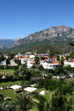 Tropical town and mountains royalty free stock photo