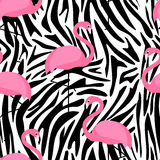 Tropical trendy seamless pattern with flamingos and zebra print. Stock Photo