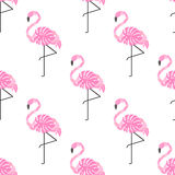Tropical trendy seamless pattern with pink decorative flamingos from palm leaves on white background. Stock Photo