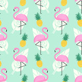 Tropical trendy seamless pattern with pink flamingos, pineapples and palm leaves on mint green background. Exotic Hawaii art background. Design for fabric Royalty Free Stock Image