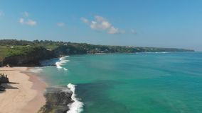 Tropical turquoise ocean with big waves and beach in Bali, aerial video. Tropical turquoise ocean with big waves and beach in Bali, aerial stock video