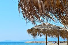 Tropical umbrellas on a beautiful beach. In northern Greece Stock Photos