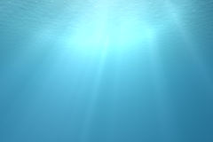 Tropical underwater scene. With sunrays shining through the water's Stock Photography