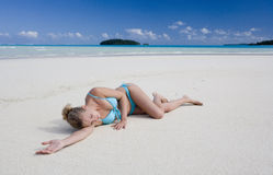 Tropical Vacation - Fiji - South Pacific Ocean. A young girl asleep on a tropical beach in Fiji in the South Pacific Royalty Free Stock Photo
