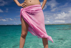 Tropical Vacation - Girl in a sarong. A teenage girl in a sarong on a tropical vacation in the Cook Islands at Aitutaki Lagoon in the South Pacific Royalty Free Stock Images