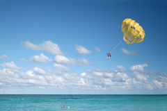 Tropical vacation Parasailing in ocean Stock Photography