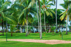 Tropical vacation resort with volleyball court Royalty Free Stock Photos