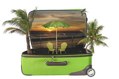Travel Tropical Vacation Sunset Hologram. Conceptual composite of 14 images - an open suitcase revealing hologram of the travel destination, or dream of - a warm royalty free illustration