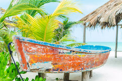 Tropical vacation view with sailboat on exotic sandy beach Stock Image