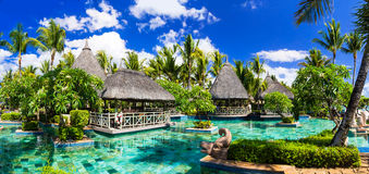 Tropical vacations. Swimming pool and lounge bar in Mauritius is Royalty Free Stock Photography