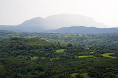 Tropical valley with high mountains. In the background Stock Photo