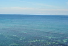 Tropical view. Calm Caribbean sea, blue sky and horizon, green water in Jamaica on our holiday stock image