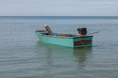 Tropical view of sea and fishing boats at Chao Lao Beach. Royalty Free Stock Images