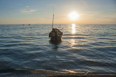 Tropical view of sea and fishing boats with sunset light at Chao Lao Beach. Stock Image