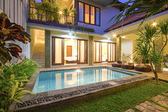 Tropical villa with a pool. Bali. Asia royalty free stock images