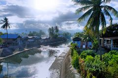 Tropical village on the banks of the river. Stock Images