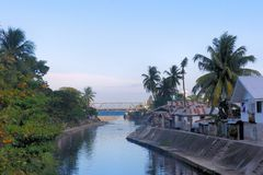 Tropical village on the banks of the river. Stock Photography