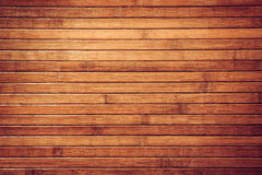 Tropical vintage  background. Horizontal retro brown  bamboo tropical background. Obsolete texture Royalty Free Stock Photography