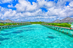 Tropical water bungalow Stock Photos