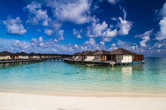 Tropical water villas resort on Maldives island at summer vacation Royalty Free Stock Images