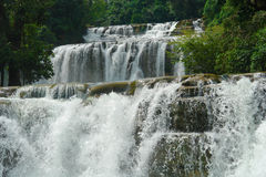 Tropical waterfall. The wide cascading Tinuy-an waterfalls near Bislig city, Mindanao, Philippines, called the Niagara of the Philippines, in a pristine virgin stock photography