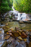 Tropical Waterfall Cascades Series 2. Waterfall in a tropical forest Royalty Free Stock Image