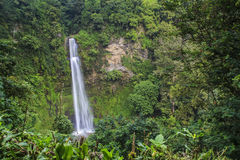 Tropical Waterfall. Cimahi Waterfall has a height of about 87 m and is located in Bandung, West Java, Indonesia Stock Images