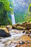 Tropical waterfall & flowing river Stock Photography