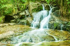 Tropical waterfall in the forest,Ton Chong Fa in khao lak Phang. Nga South of Thailand stock photo