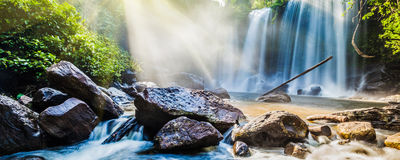 Tropical waterfall in jungle with sun rays Royalty Free Stock Photography