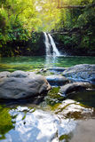 Tropical waterfall Lower Waikamoi Falls and a small crystal clear pond, inside of a dense tropical rainforest, off the Road to Han Stock Photo