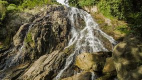 Tropical waterfall in rocks. Tropical jungles waterfall in rocks stock video