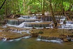 Tropical waterfall thailand. Huay Mae Khamin Sixth Level, Paradise Waterfall located in deep forest of Thailand Stock Photos