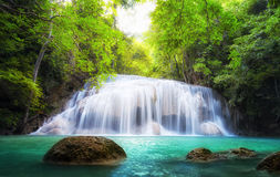 Tropical waterfall in Thailand, nature photography. Fresh water mountain river in wild green jungle forest. Scenic and peaceful Asia nature background of Stock Images