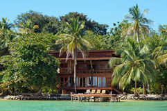 Tropical waterfront beach house Stock Photo