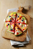Tropical watermelon pizza for a party dessert Stock Photo