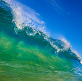 Tropical Wave. Blue Surfing Wave Breaks in Ocean Stock Photos