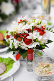 Tropical wedding bouquet. In glass holder on table stock photography
