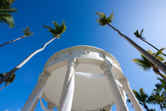 Tropical wedding gazebo. Perfect place to get married under the blue skies and palm trees royalty free stock image