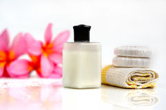 Tropical wellness spa. & aromatherapy concept with plumeria flower, soap and towel,  on white background Royalty Free Stock Photography