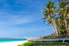 Tropical white beach view and lonely sailboat Royalty Free Stock Image